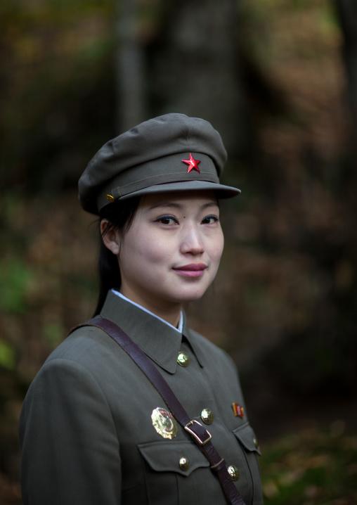 Portrait of a cute North Korean guide in military style uniform, Ryanggang Province, Chongbong, North Korea
