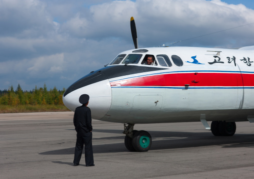 North Korean employee in front of an air Koryo domestic plane on Samjiyon airport, Ryanggang Province, Samjiyon, North Korea