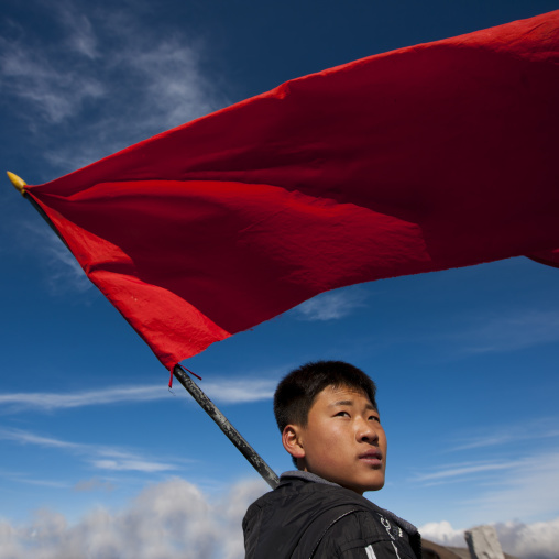 North Korean student with red flag in mount Paektu, Ryanggang Province, Mount Paektu, North Korea