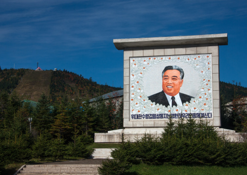Smiling Kim il Sung on a propaganda fresco saying the great leader comrade Kim il Sung will always be with our people, Ryanggang Province, Samjiyon, North Korea