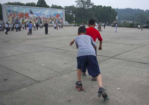 North Korean children roller skating in town, Pyongan Province, Pyongyang, North Korea