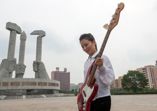 North Korean state artist performing on national day in front of the monument to Party founding, Pyongan Province, Pyongyang, North Korea
