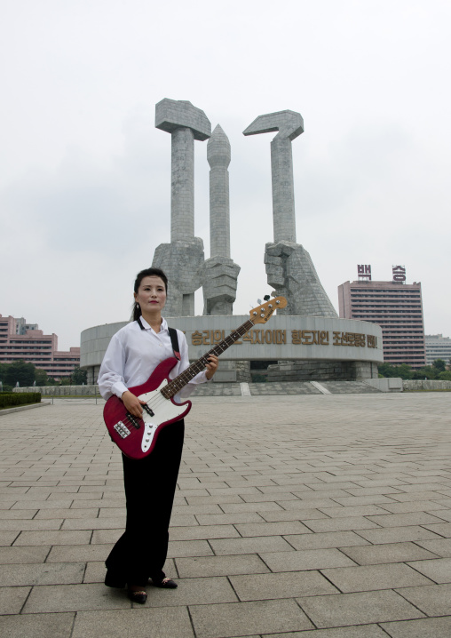 North Korean state artist bassist on national day in front of the monument to the founding of the Party, Pyongan Province, Pyongyang, North Korea