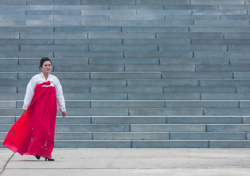 Portrait of a North Korean woman in traditional choson-ot in front of large stairs, Pyongan Province, Pyongyang, North Korea