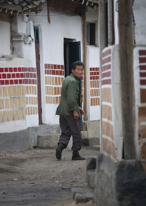 North Korean man passing through a narrow street in the old town, North Hwanghae Province, Kaesong, North Korea