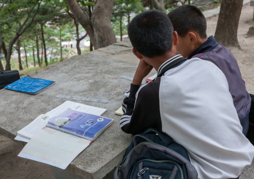 North Korean children studying english in a park, North Hwanghae Province, Kaesong, North Korea