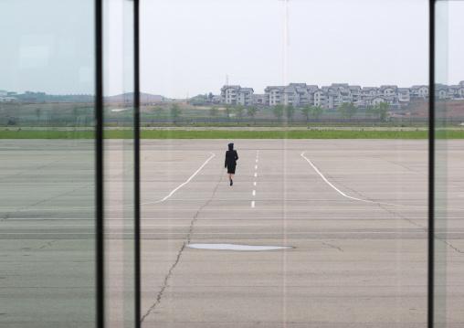 North Korean airport employee on the tarmac in Sunan international airport, Pyongan Province, Pyongyang, North Korea