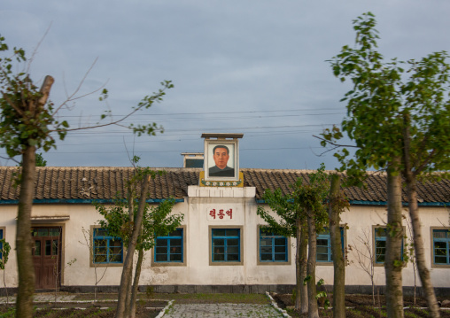 Kim il Sung portrait at the top of an official building, South Pyongan Province, Nampo, North Korea