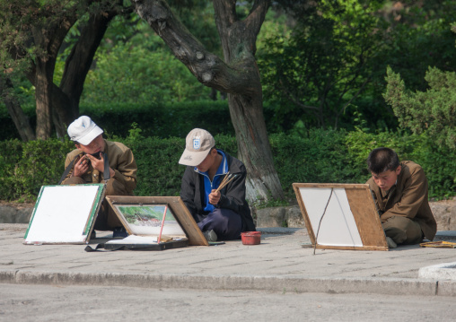 North Korean students drawing in the street, North Hwanghae Province, Kaesong, North Korea