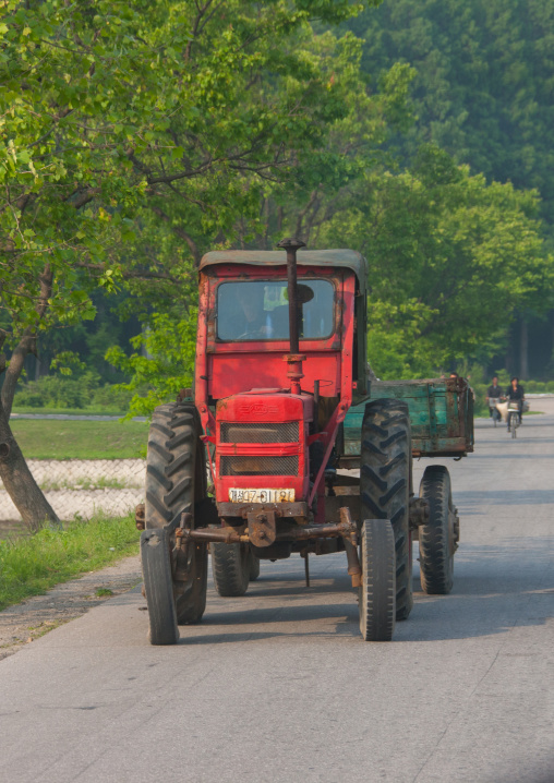 Old North Korean tractor on the road in the countryside, North Hwanghae Province, Kaesong, North Korea