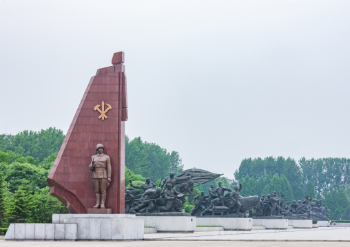 North Korean soldier statue with the workers' Party of North Korea flag, Pyongan Province, Pyongyang, North Korea