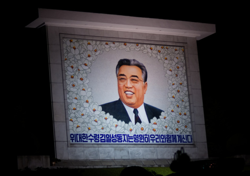Smiling Kim il Sung on a propaganda fresco saying the great leader comrade Kim il Sung will always be with our people, Pyongan Province, Pyongyang, North Korea