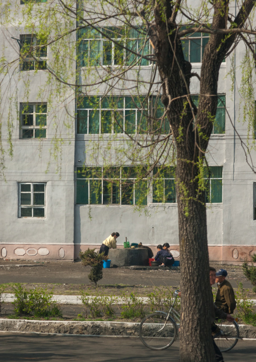 North Korean women taking water from a well in the city center, Kangwon Province, Wonsan, North Korea
