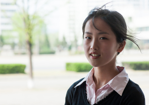 Portrait of a North Korean young woman in the street, Pyongan Province, Pyongyang, North Korea