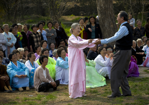 North Korean people dancing in a park for the day of the sun which is the birth anniversary of Kim Il-sung, Pyongan Province, Pyongyang, North Korea