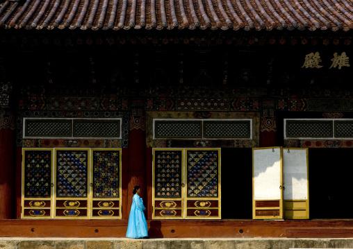 North Korean woman in choson-ot in front of Pohyon-sa Korean buddhist temple, Hyangsan county, Mount Myohyang, North Korea