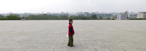 North Korean child in Mansudae Grand monument, Pyongan Province, Pyongyang, North Korea