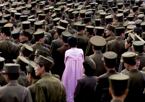 North Korean woman in pink choson-ot in the middle of soldiers, Pyongan Province, Pyongyang, North Korea
