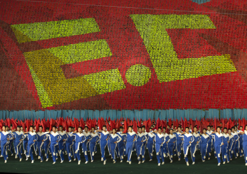 Anti capitalism human fresco made by children pixels holding up colored boards during Arirang mass games in may day stadium, Pyongan Province, Pyongyang, North Korea