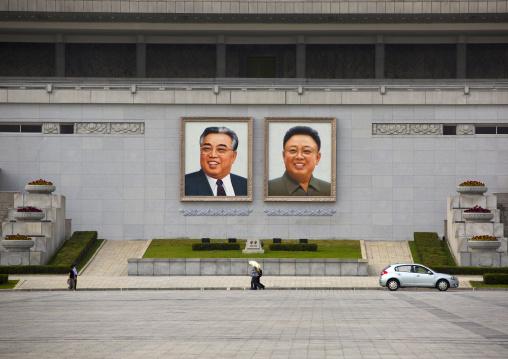 Kim il Sung and Kim Jong il giant portraits on Kim il Sung square, Pyongan Province, Pyongyang, North Korea