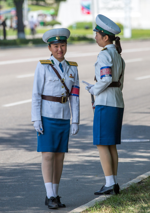 North Korean traffic security officers in white uniforms in the street, Pyongan Province, Pyongyang, North Korea