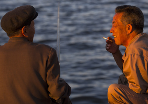 North Korean men fishing and chatting, Kangwon Province, Wonsan, North Korea