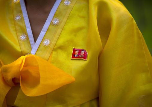 Close-up of the Dear Leaders badge on the traditional choson-ot of a North Korean woman, South Hamgyong Province, Hamhung, North Korea