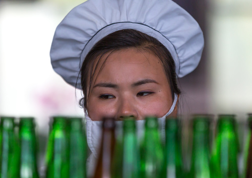 North Korean female worker in kangso yaksu mineral water factory, South Pyongan Province, Nampo, North Korea