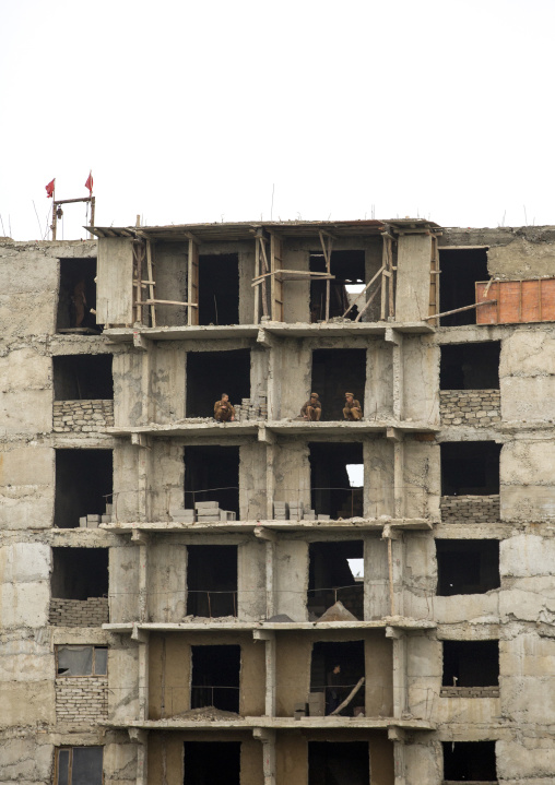 North Korean soldiers working as construction workers in a building, Pyongan Province, Pyongyang, North Korea