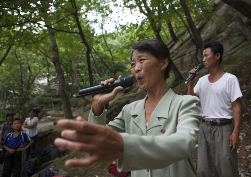 North Korean electricity company worker singing in a park, North Hwanghae Province, Kaesong, North Korea