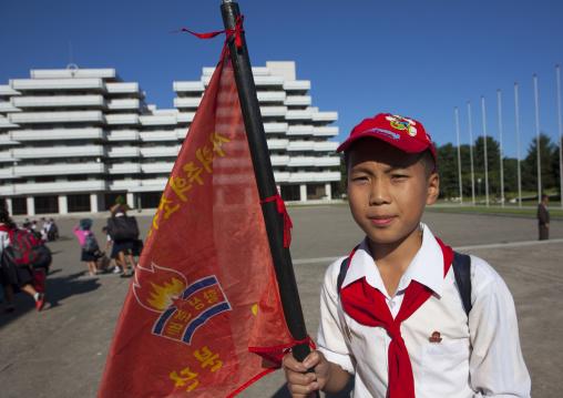 North Korean pioneer holding a flag in Songdowon international children's camp, Kangwon Province, Wonsan, North Korea