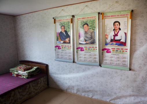 Bedroom in a North Korean house with the Dear Leaders portraits on the wall, South Hamgyong Province, Hamhung, North Korea
