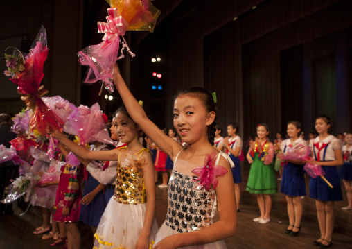 Young North Korean artists with flowers at the end of their show in Mangyongdae children's palace, Pyongan Province, Pyongyang, North Korea