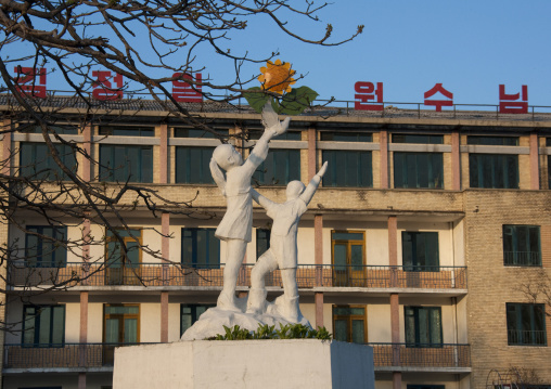 Statues of children and dove in the sunset in Tchang Gwang school kindergarden, North Hamgyong Province, Chongjin, North Korea