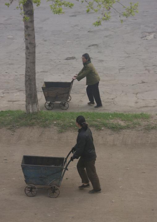 North Korean people pushing carts in the street, North Hamgyong Province, Chongjin, North Korea