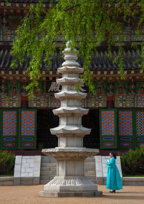 North Korean woman in front of the pagoda of Kwangbop temple, Pyongan Province, Pyongyang, North Korea