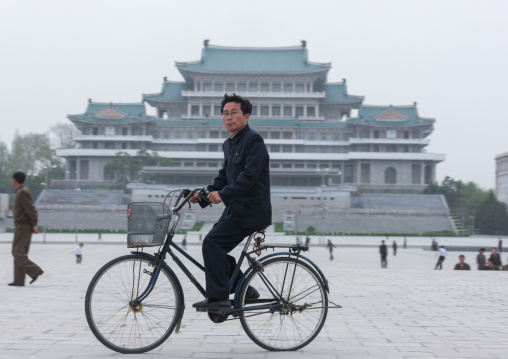 North Korean man riding a bicycle on Kim il Sung square, Pyongan Province, Pyongyang, North Korea