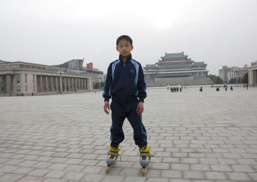 North Korean boy with rollers on Kim il Sung square, Pyongan Province, Pyongyang, North Korea
