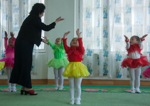 North Korean ballet dancers children in Kim Jong suk school with their teacher, Pyongan Province, Pyongyang, North Korea