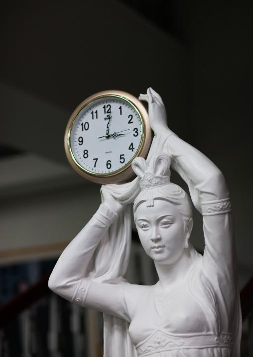 Statue of a woman holding a clock, Pyongan Province, Pyongyang, North Korea