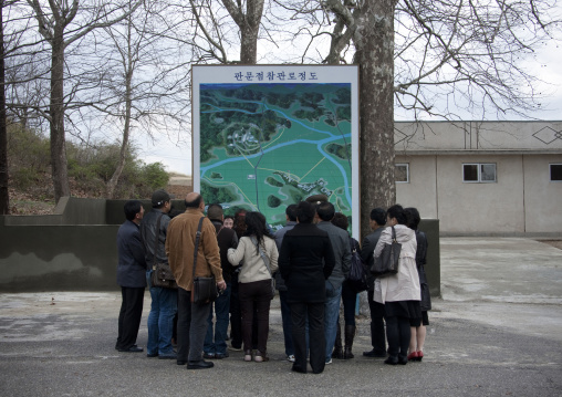 Tourists in front of a map of the Demilitarized Zone, North Hwanghae Province, Panmunjom, North Korea