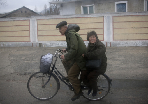 North Korean old coule on a bicycle, North Hwanghae Province, Kaesong, North Korea