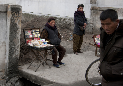 North Korean woman selling cigarettes in the street, North Hwanghae Province, Kaesong, North Korea