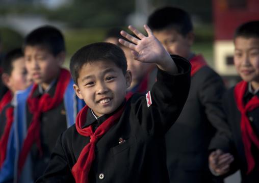 North Korean pioneer boy waving hand, Pyongan Province, Pyongyang, North Korea