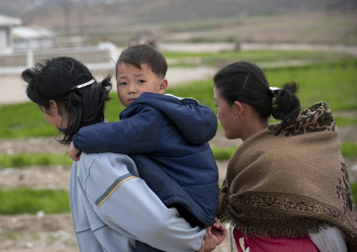 North Korean woman carrying her children on her back, Kangwon Province, Wonsan, North Korea
