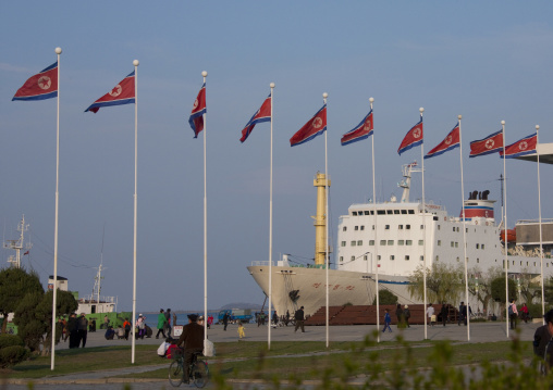 Ship in front of North Korean flags in the city, Kangwon Province, Wonsan, North Korea
