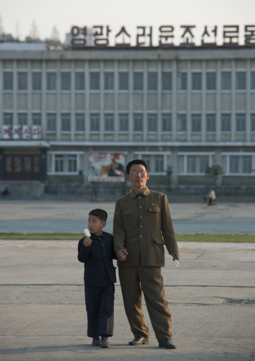 North Korean father and son eating an ice cream in the main square, Kangwon Province, Wonsan, North Korea