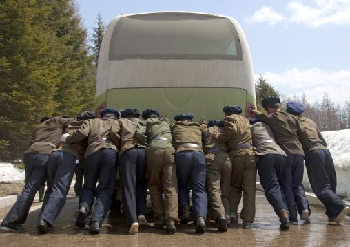 North Korean students pushing a bus out of order, Ryanggang Province, Samjiyon, North Korea