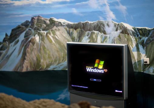 Windows computer in front of mountain decor of mount Paektu, Ryanggang Province, Samjiyon, North Korea