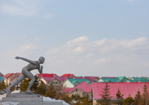 Statue of a ice skaters in front of new apartment houses, Ryanggang Province, Samjiyon, North Korea